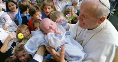 ARS, FRANCE:  Pope John Paul II blesses 06 October 1986 in Ars a baby during the third day of his visit to Lyon's area. The pontiff was visiting from 04 to 07 October East and Central regions of France (it was his 31th International Pastoral visit).  AFP PHOTO DANIEL JANIN (Photo credit should read DANIEL JANIN/AFP/Getty Images)
