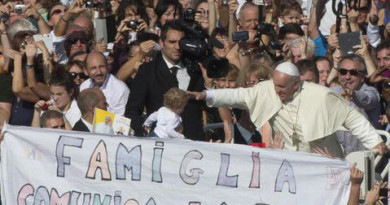 "Pope Francis is driven past a banner reading ""Family communicates faith"" as he leaves St. Peter's Square at the Vatican, Sunday, Oct.27, 2013. Pope Francis led a Mass on the occasion of the meeting with families. (AP Photo/Alessandra Tarantino)"