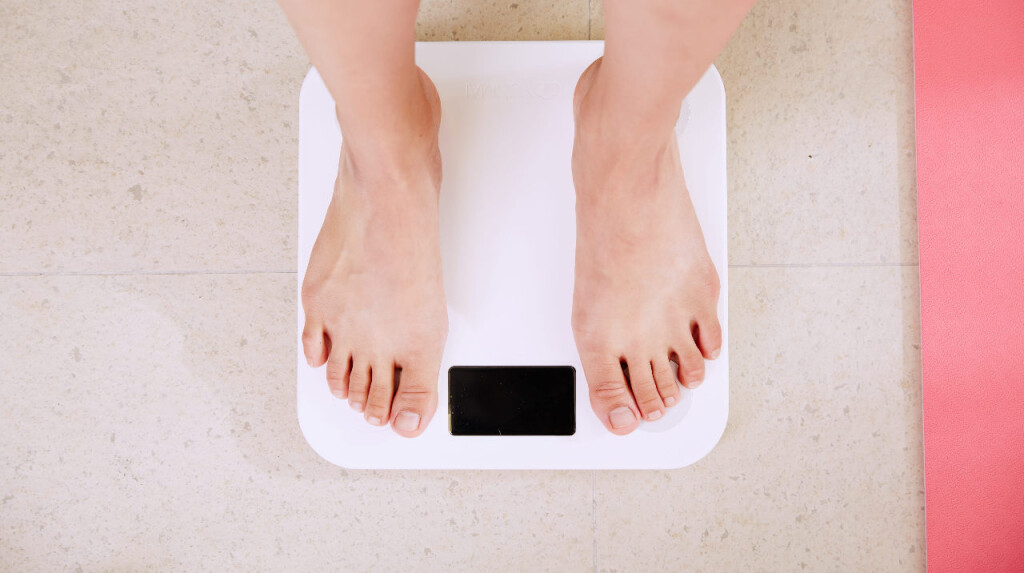 woman-standing-on-scale-e1587156177669